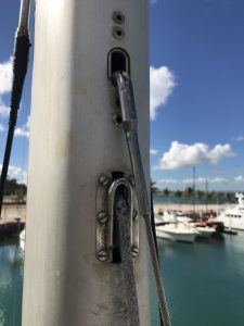 sheave used for both pole topping lift, and as staysail halyard. Note anti-chafe rods.
